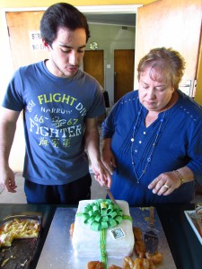 Leandro and Rynette cutting the YFU birthday cake